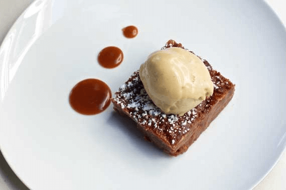 Chocolate brownie dessert with coffee ice cream